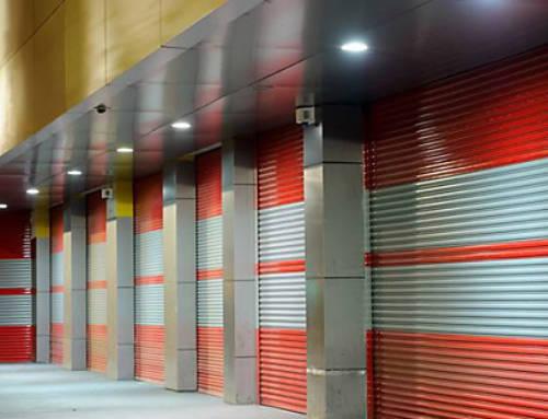 Exterior Of A Commercial Warehoue With Orange Roller Doors